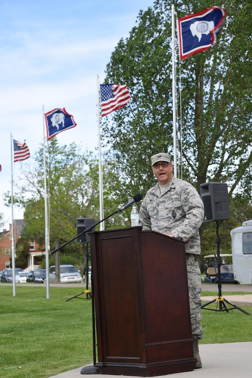 Colonel Stephen Kravitsky, 90th Missile Wing commander, speaks at the 90th Mission Support Group Change of Command on the Argonne Parade Field at F.E. Warren Air Force Base, Wyo., June 16, 2017. Kravitsky spoke about Col. Frank Verdugo's achievements in his tenure at the 90th MSG, as well as why Col. Tricia Van Den Top is the right fit to succeed Verdugo and assume command of the group. (U.S. Air Force photo by Glenn S. Robertson)