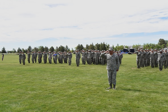 Airmen in the 90th Mission Support Group render a final salute to Col. Frank Verdugo, their outgoing commander, at the 90th MSG Change of Command on the Argonne Parade Field at F.E. Warren Air Force Base, Wyo., June 16, 2017. Col. Tricia Van Den Top assumed command of the group during the ceremony which represents a formal transition of authority from the outgoing commander to the incoming commander. (U.S. Air Force photo by Glenn S. Robertson)
