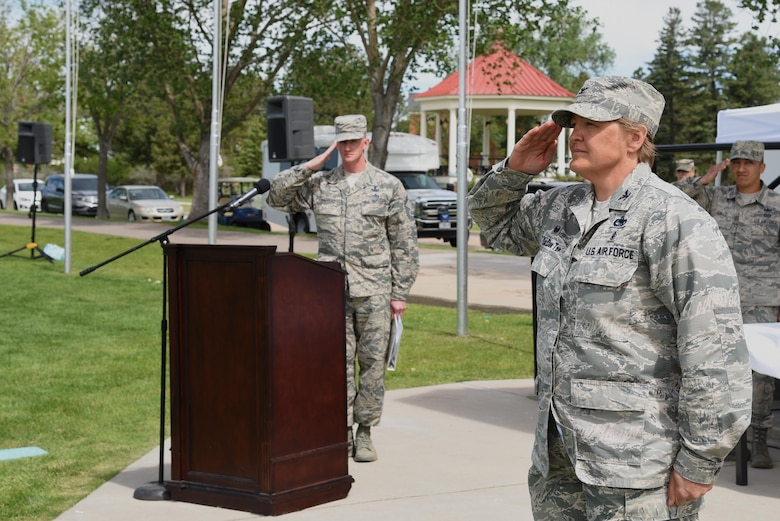Colonel Tricia Van Den Top renders her first salute as commander to her troops at the 90th MSG Change of Command on the Argonne Parade Field at F.E. Warren Air Force Base, Wyo., June 16, 2017. Van Den Top assumed command of the group during the ceremony which represents a formal transition of authority from the outgoing commanding to the incoming commander. (U.S. Air Force photo by Glenn S. Robertson)