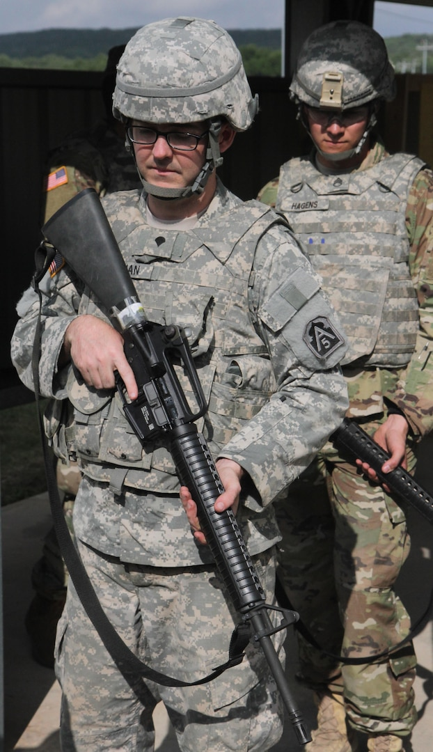 """Spc. Kylie Noonan, 323rd Army Band """"Fort Sam's Own,"""" U.S. Army North, prepares to clear his M-16 rifle June 13 after the Best Warrior Competition at Joint Base San Antonio-Camp Bullis."""