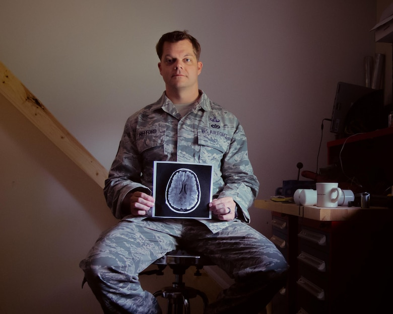 Tech. Sgt. Lucas Mefford, 11th Civil Engineer explosive ordinance disposal craftsman, holds a scan of his brain at Joint Base Andrews, Md., May 29, 2017.  Mefford attended an inpatient program at the National Intrepid Center of Excellence program, in Bethesda, Md., for depression, insomnia, and other symptoms caused by a traumatic brain injury. He continues his medical treatment at JBA and hopes to influence his Airmen to be advocates for their health. (U.S. Air Force photo by Senior Airman Mariah Haddenham)
