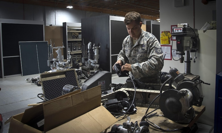 Tech. Sgt. Lucas Mefford, 11th Civil Engineer explosive ordinance disposal craftsman, inspects a functioning dismounted robot system, at Joint Base Andrews, Md., June 6, 2017. Mefford attended an inpatient program at the National Intrepid Center of Excellence program, in Bethesda, Md., for depression, insomnia, and other symptoms. He continues his medical treatment at JBA and hopes to influence his Airmen to be advocates for their health. (U.S. Air Force photo by Senior Airman Mariah Haddenham)