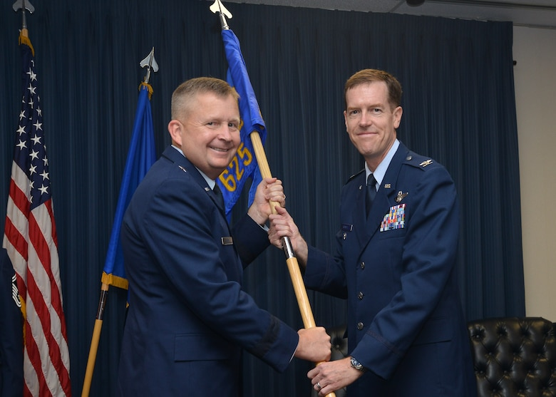 Col. Christopher Russell accepts command of the 625th Operations Center from Brig. Gen. James Cluff, vice commander, 25th Air Force, June 16.
