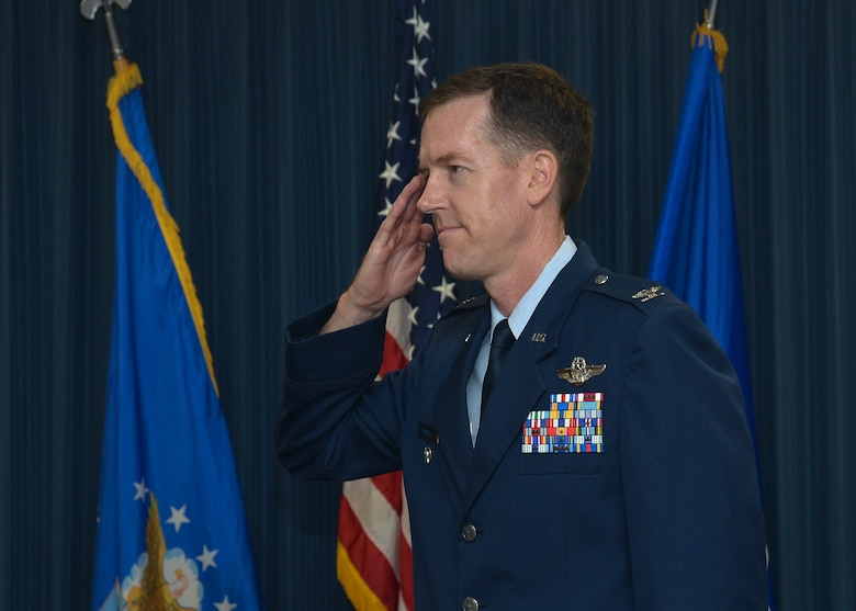 Col. Christopher Russell, commander, 625th Operations Center, renders his first salute to a flight of Airmen from the Operations Center.