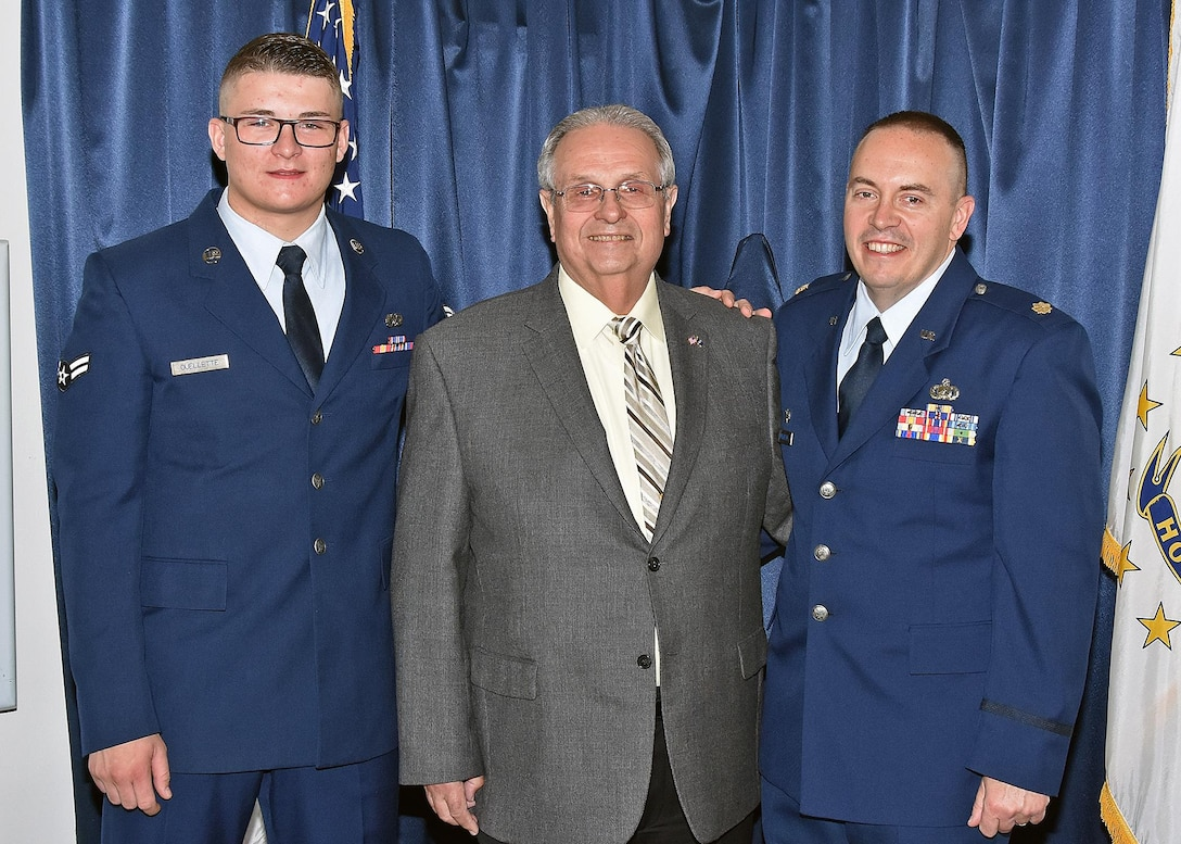 Major Edward Ouellette Junior assumes command of the 143d Force Support Squadron during a ceremony held at Quonset Air National Guard Base, North Kingstown, Rhode Island. Major Ouellette's father, retired Lieutenant Colonel Edward Ouellette Senior is the former commander of the Force Support Squadron. Airman First Class Dylan Ouellette, 143d Maintenance Squadron, Major Ouellette's son, serves as the master of ceremonies for the event.