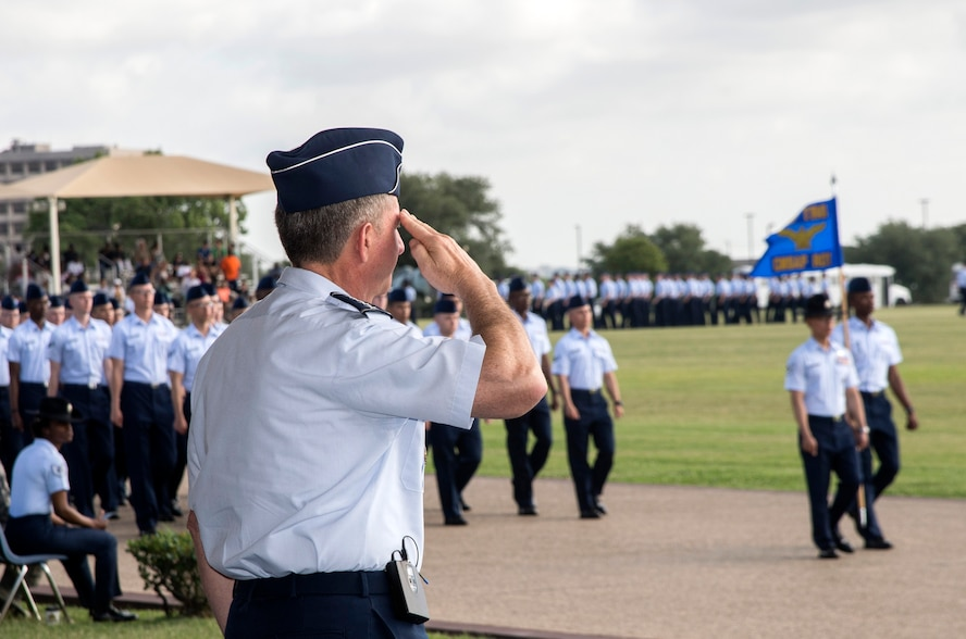 """Air Force Chief of Staff Gen. David Goldfein salutes a flight of the Air Force's newest Airmen June 16, 2017, at Joint Base San Antonio-Lackland. Goldfein toured various JBSA-Lackland facilities and met many 37th Training Wing Airmen during his two-day visit. Every enlisted Airmen begins their Air Force career at basic military training. JBSA-Lackland is often referred to as the """"Gateway to the Air Force,"""" graduating about 39,000 Airmen annually. Basic military training is one of the missions of the 37th Training Wing, the largest training wing in the United States Air Force. (U.S. Air Force photo by Johnny Saldivar)"""