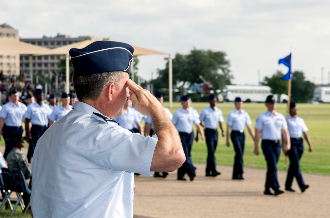 "Air Force Chief of Staff Gen. David Goldfein salutes a flight of the Air Force's newest Airmen June 16, 2017, at Joint Base San Antonio-Lackland. Goldfein toured various JBSA-Lackland facilities and met many 37th Training Wing Airmen during his two-day visit. Every enlisted Airmen begins their Air Force career at basic military training. JBSA-Lackland is often referred to as the ""Gateway to the Air Force,"" graduating about 39,000 Airmen annually. Basic military training is one of the missions of the 37th Training Wing, the largest training wing in the United States Air Force. (U.S. Air Force photo by Johnny Saldivar)"