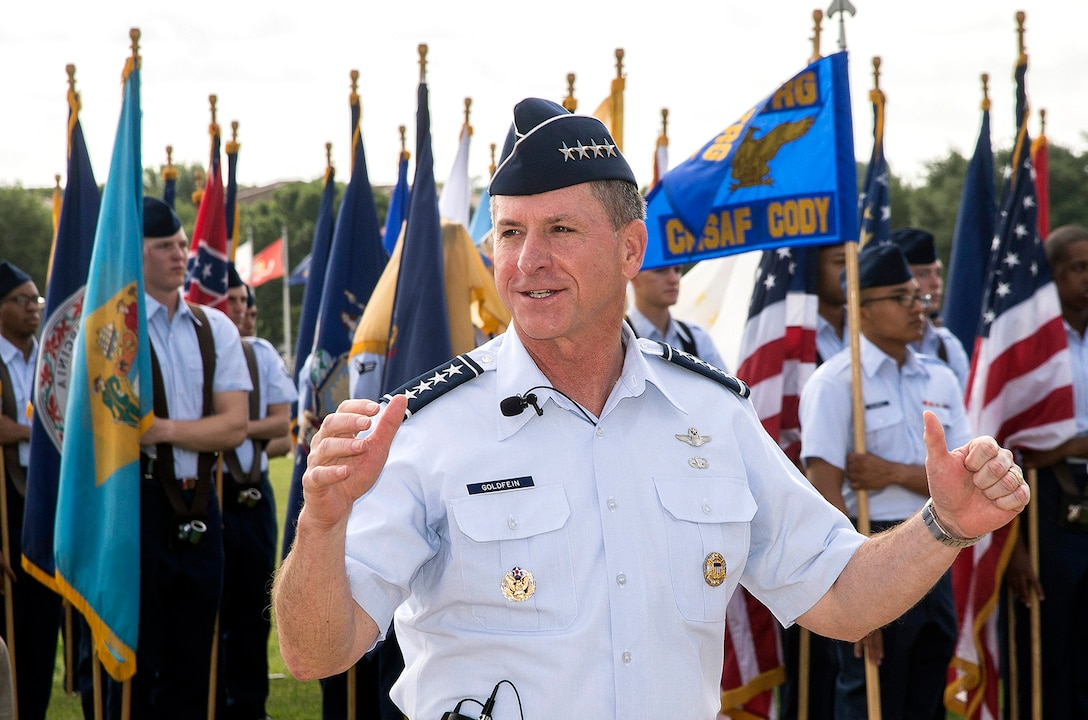 """Air Force Chief of Staff Gen. David Goldfein addresses the crowd during a basic military training graduation June 16, 2017, at Joint Base San Antonio-Lackland. Goldfein toured various JBSA-Lackland facilities and met many 37th Training Wing Airmen during his two-day visit. Every enlisted Airmen begins their Air Force career at basic military training. JBSA-Lackland is often referred to as the """"Gateway to the Air Force,"""" graduating about 39,000 Airmen annually. BMT is one of the missions of the 37th Training Wing, the largest training wing in the United States Air Force. (U.S. Air Force photo by Johnny Saldivar)"""