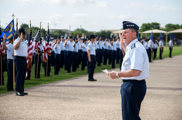 """Air Force Chief of Staff Gen. David Goldfein performs the oath of enlistment to Airmen during a basic military training graduation June 16, 2017, at Joint Base San Antonio-Lackland. Goldfein toured various JBSA-Lackland facilities and met many 37th Training Wing Airmen during his two-day visit. Every enlisted Airmen begins their Air Force career at basic military training. JBSA-Lackland is often referred to as the """"Gateway to the Air Force,"""" graduating about 39,000 Airmen annually. BMT is one of the missions of the 37th Training Wing, the largest training wing in the United States Air Force. (U.S. Air Force photo by Johnny Saldivar)"""