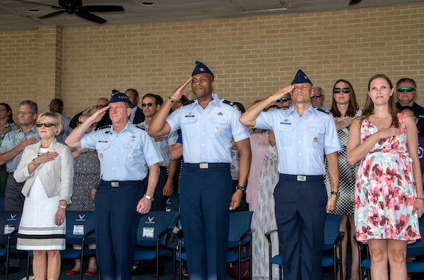 """Air Force Chief of Staff Gen. David Goldfein, salutes during the playing of the national anthem as part of a basic military training graduation June 16, 2017, at Joint Base San Antonio-Lackland. Goldfein toured various JBSA-Lackland facilities and met many 37th Training Wing Airmen during his two-day visit. Every enlisted Airmen begins their Air Force career at basic military training. JBSA-Lackland is often referred to as the """"Gateway to the Air Force,"""" graduating about 39,000 Airmen annually. Basic military training is one of the missions of the 37th Training Wing, the largest training wing in the United States Air Force. (U.S. Air Force photo by Johnny Saldivar)"""