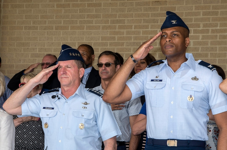 """Air Force Chief of Staff Gen. David Goldfein and Col. Roy Collins, 37th Training Wing commander, salute during the playing of the national anthem as part of a basic military training graduation June 16, 2017, at Joint Base San Antonio-Lackland. Goldfein toured various JBSA-Lackland facilities and met many 37th Training Wing Airmen during his two-day visit. Every enlisted Airmen begins their Air Force career at basic military training. JBSA-Lackland is often referred to as the """"Gateway to the Air Force,"""" graduating about 39,000 Airmen annually. Basic military training is one of the missions of the 37th Training Wing, the largest training wing in the United States Air Force. (U.S. Air Force photo by Johnny Saldivar)"""
