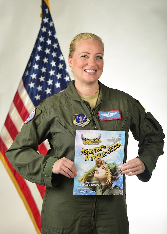 """Maj. Amanda Coonradt, an LC-130 Skibird navigator with the 109th Airlift Wing, recently self-published a children's book, """"Air Force Amanda: Adventure in Antarctica."""" The book talks about Antarctica through the perspective of an LC-130 navigator. (U.S. Air National Guard photo by Staff Sgt. Benjamin German/Released)"""