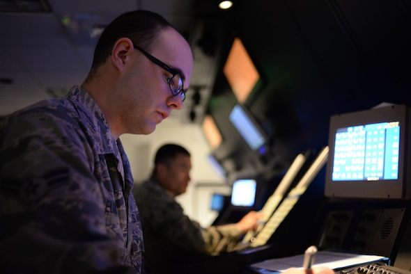 Airman 1st Class Alan Elkins, 14th Operation Support Squadron Air Traffic Controller, practices a position in the Radar Approach Control room May 31, 2017, on Columbus