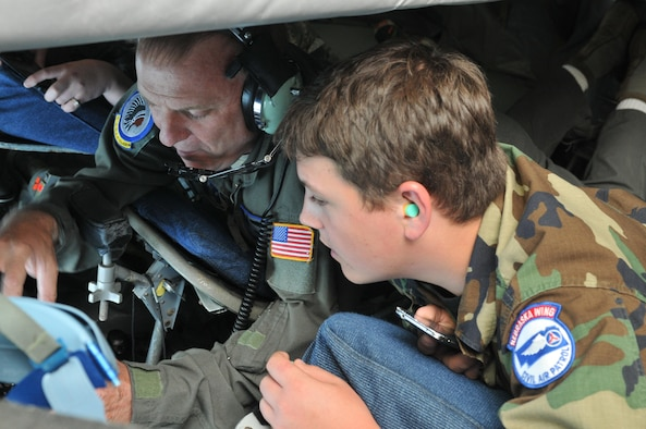 In-Flight Refueling Specialist, Senior Master Sgt. Charles Heald explains some of the details of in-air refueling to CAP Cadet Dominic Vaul, while in the boom pod of an Air National Guard KC-135 Stratotanker, while refueling F-16 Fighting Falcons over Lake Superior Thursday. (U.S. Air National Guard photo by Staff Sgt. David Asbra/Released)