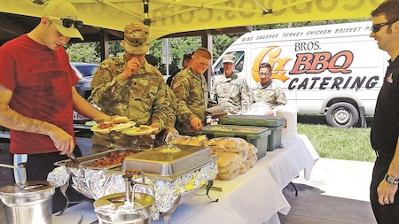 Fort Riley Soldiers joined in the Better Opportunities for Single Soldiers barbecue May 25 between the old and new hospital on Historic Main Post. The event was sponsored by Cox Bros. BBQ from Manhattan, Kansas.