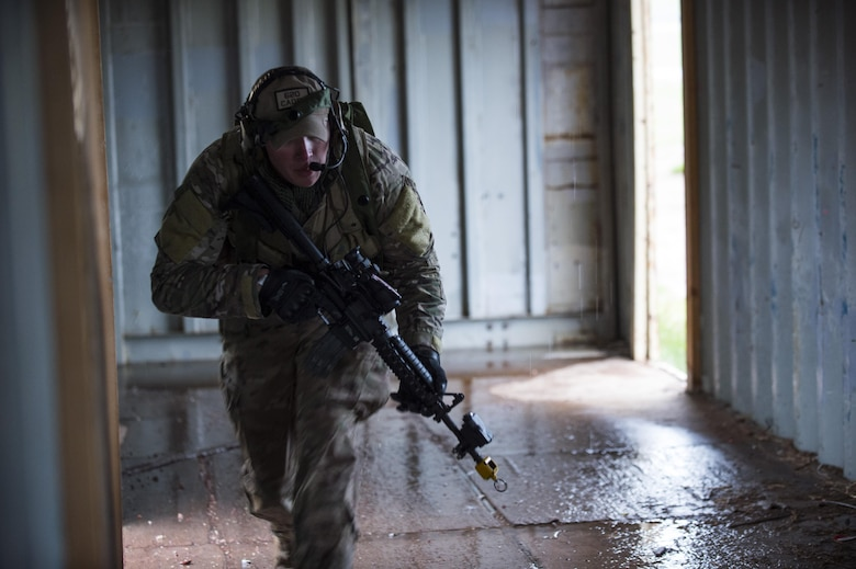 Staff Sgt. Samuel Saintz, 620th Ground Combat Training Squadron formal training instructor, scurries through a facility to get into a fighting position during the 2017 Global Strike Challenge at Camp Guernsey, Wyo., May 18, 2017. The winners from each challenge will be announced in August at the 2017 Global Strike Command Innovation and Technology Symposium in Shreveport, La. (U.S. Air Force photo by Staff Sgt. Christopher Ruano)
