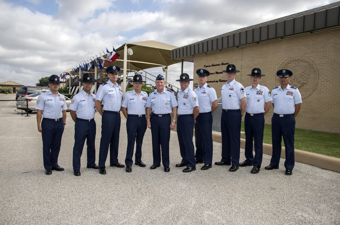 "Air Force Chief of Staff Gen. David Goldfein takes a photo with military training instructors after a basic military training graduation June 16, 2017, at Joint Base San Antonio-Lackland. Goldfein toured various JBSA-Lackland facilities and met many 37th Training Wing Airmen during his two-day visit. Every enlisted Airmen begins their Air Force career at basic military training. JBSA-Lackland is often referred to as the ""Gateway to the Air Force,"" graduating about 39,000 Airmen annually. BMT is one of the missions of the 37th Training Wing, the largest training wing in the United States Air Force. (U.S. Air Force photo by Johnny Saldivar)"