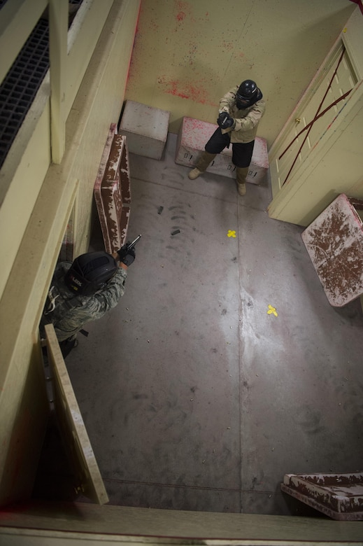 A security forces member with the 28th Security Forces Squadron from Ellsworth Air Force Base, S.D., enters a room to engage an enemy target during the 2017 Global Strike Challenge at Camp Guernsey, Wyo., May 18, 2017. Defenders were tested on marksmanship, navigation, self-aid buddy care and tactics throughout the week-long security forces portion of the competition. (U.S. Air Force photo by Staff Sgt. Christopher Ruano)