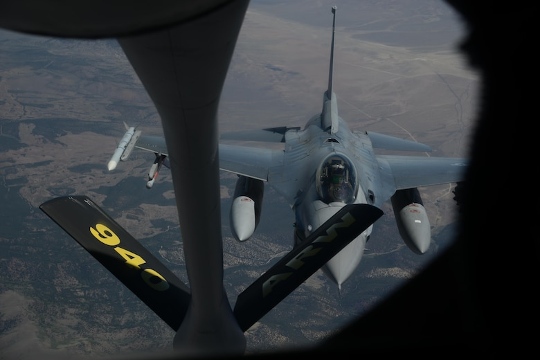 An F-16C Fighting Falcon from the 388th Fighter Wing at Hill Air Force Base, Utah, flies behind a KC-135 Stratotanker from the 314th Air Refueling Squadron at Beale AFB, California, June 9, 2017. The Fighting Falcon was refueled by the Stratotanker during an air refueling trainer mission. (U.S. Air Force photo by Airman 1st Class Andrew Moore)