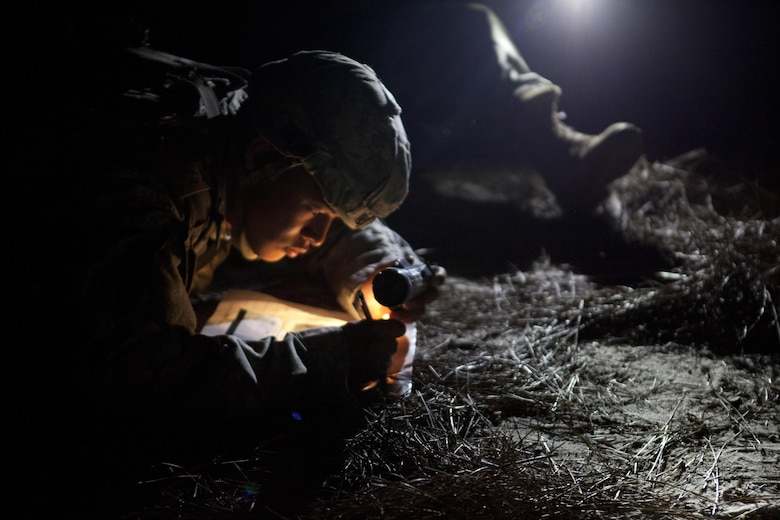 Warrior Spc. Kenny Ochoa a watercraft specailist representing the 79th Sustainment Support Command competing in the land navigation course during the 2017 U.S. Army Reserve Best Warrior Competition at Fort Bragg, N.C. June14. This year's Best Warrior Competition will determine the top noncommissioned officer and junior enlisted Soldier who will represent the U.S. Army Reserve in the Department of the Army Best Warrior Competition later this year at Fort A.P. Hill, Va. (U.S. Army Reserve photo by Spc. Noel Williams) (Released)