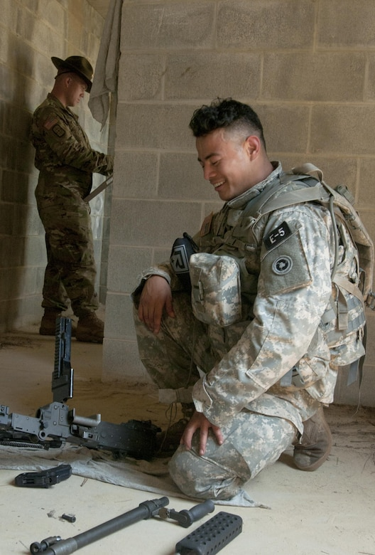 Spc. Kenny Ochoa, an Army Reserve watercraft operator from Chatsworth, Calif., representing the 79th Sustainment Support Command, disassembles an automatic weapon at the 2017 U.S. Army Reserve Best Warrior Competition at Fort Bragg, N.C. June 14. This year's Best Warrior Competition will determine the top noncommissioned officer and junior enlisted Soldier who will represent the U.S. Army Reserve in the Department of the Army Best Warrior Competition later this year at Fort A.P. Hill, Va. (U.S. Army Reserve photo by SGT David Turner) (Released)