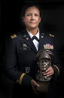 Chief Warrant Officer 2 Jennifer Pace poses for a portrait in Baltimore, Maryland, June 15, where she used to work as a police officer before committing her career full time to the U.S. Army Reserve. Pace is among this year's recipients of the General Douglas MacArthur Leadership Award, which she won as a property book officer while working for the 290th Military Police Brigade, headquartered in Nashville, Tennessee. In her leadership journey and professional growth, Pace overcame the loss of her brother, Danny Gamez, who passed away in 2011. (U.S. Army Reserve photo by Master Sgt. Michel Sauret)