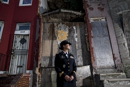 Chief Warrant Officer 2 Jennifer Pace poses for a portrait in West Baltimore, Maryland, June 15, where she used to work as a police officer before committing her career full time to the U.S. Army Reserve. Pace is among this year's recipients of the General Douglas MacArthur Leadership Award, which she won as a property book officer while working for the 290th Military Police Brigade, headquartered in Nashville, Tennessee. In her leadership journey and professional growth, Pace overcame the loss of her brother, Danny Gamez, who passed away in 2011. (U.S. Army Reserve photo by Master Sgt. Michel Sauret)