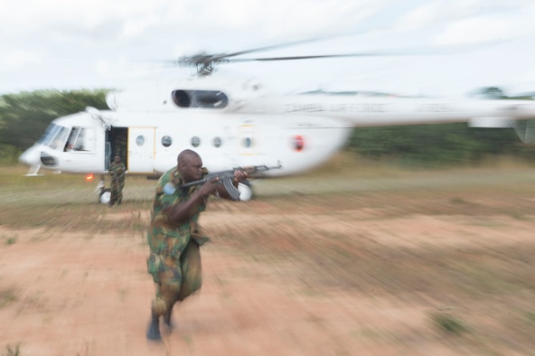 A Zambian Air Force Airman runs quickly and aims his weapon as he attempts to establish security during fly away security training in Lusaka, Zambia, June 1, 2017. (U.S. Air Force photo by Tech. Sgt. Gustavo Gonzalez/RELEASED)