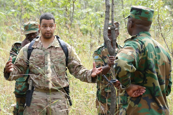 Staff Sgt. David Foreman, 305th Operation Support Squadron survival specialist stationed at Joint Base McGuire-Dix-Lakehurst, N.J., instructs Zambian Air Force Airmen during an 818th Mobility Support Advisory Squadron building partner capacity mission in Lusaka, Zambia, May 30, 2017. Air mobility can provide partner nations a means of air transportation to access remote regions and deliver resources and personnel to address a wide variety of issues. (U.S. Air Force photo by Tech. Sgt. Gustavo Gonzalez/RELEASED)