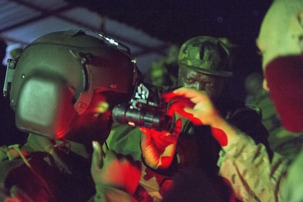 A Zambian Air Force Airman trains on the night vision goggles with members of the 818th Mobility Support Advisory Squadron in Lusaka, Zambia, May 31, 2017. The MSAS illustrates the U.S. commitment with regional partners in ways that expand cooperation between counterparts, bolster partner nation capacity, enhance trust and transparency, and create cooperative solutions. (U.S. Air Force photo by Tech. Sgt. Gustavo Gonzalez/RELEASED)