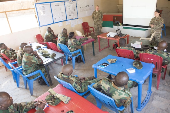 U.S. Air Force Staff Sgt. Evan Gohring and Tech. Sgt. Kara Offner, 818th Mobility Support Advisory Squadron air advisors stationed at Joint Base McGuire-Dix-Lakehurst, N.J., brief Zambian Air Force Airmen on command post procedures during a building partner capacity mission in Lusaka, Zambia, May 29, 2017. The Zambian Air Force is preparing for their first deployment ever in a U.N. humanitarian mission in South Sudan in a few months. MSAS plays an essential role in establishing and maintaining relations with strategic partner nations such as Zambia. (U.S. Air Force photo by Tech. Sgt. Gustavo Gonzalez/RELEASED)