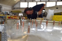 """DAYTON, Ohio (06/2017) -- Restoration Specialist Duane Jones works on the B-17F """"Memphis Belle""""™ in the restoration hangar at the National Museum of the U.S. Air Force. The exhibit opening for this aircraft is planned for May 17, 2018.(U.S. Air Force photo by Ken LaRock)"""