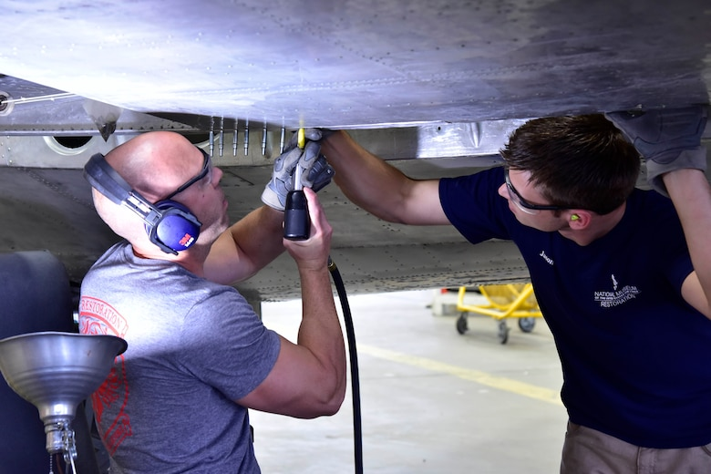 "DAYTON, Ohio (06/2017) -- (From left to right) Restoration Specialists Chase Meredith and Jason Davis work on the B-17F ""Memphis Belle""™ in the restoration hangar at the National Museum of the U.S. Air Force. The exhibit opening for this aircraft is planned for May 17, 2018.(U.S. Air Force photo by Ken LaRock)"