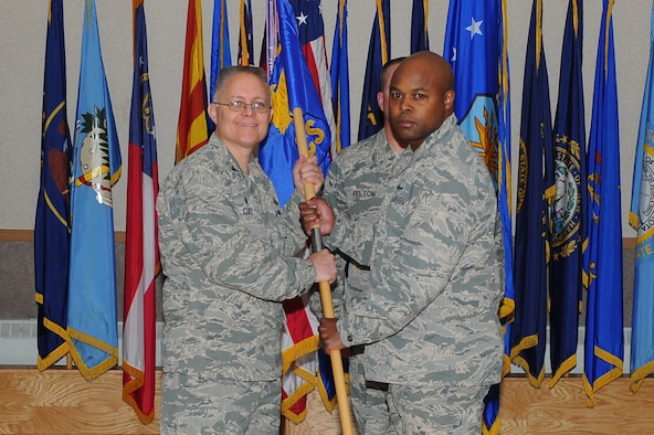 U.S. Air Force Col. Richard Cole, left, the 354th Mission Support Group commander, passes the 354th Communications Squadron (354th CS) guidon to Maj. Charles Dobson, the 354th CS commander, June 15, 2017, at Eielson Air Force Base, Alaska. Dobson assumed command from Maj. Aaron Lake who will move on to Maxwell Air Force Base, Alabama. (U.S. Air Force photo by Airman Eric M. Fisher)