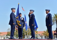 Lt. Gen. John Thompson, incoming SMC commander, salutes Gen. John Raymond, Air Force Space Command commander, as Lt. Gen. Samuel Greaves, outgoing SMC commander looks on during the SMC change of command ceremony, May 22. (US Air Force photo/Van Ha)