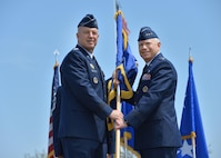Lt. Gen. John Thompson, incoming SMC commander, accepts the flag of command from Gen. John Raymond, commander of Air Force Space Command, during a change of command ceremony May 22 on the parade grounds of historic Fort MacArthur in San Pedro. (US Air Force photo/Van Ha)