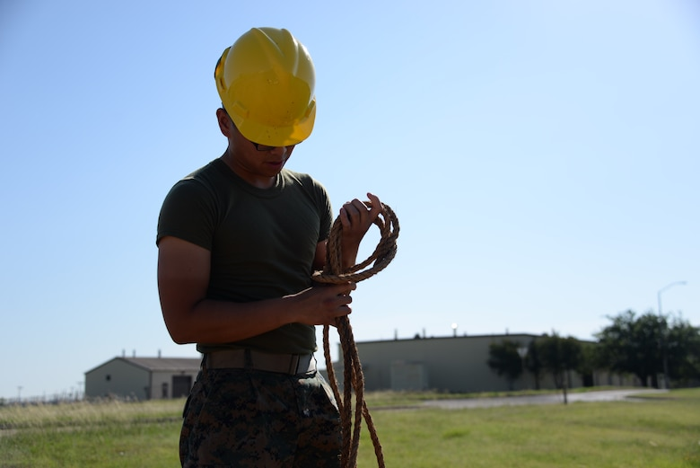 Lance Cpl. Jeffrey Regullano, 364th Training Squadron cables and antenna systems apprentice course student, daisy chains rope before storage. Daisy chaining saves space, keeps everything organized and makes it readily available for use. (U.S. Air Force photo by Senior Airman Robert L. McIlrath)