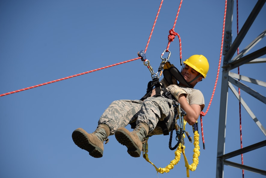 Airman 1st Class Ryan Ferguson, 364th Training Squadron cables and antenna systems apprentice course student, trains on how to do a ground based belay assist tower rescue. Several situations like equipment failure or injury could leave the climber unable to descend the tower on their own. This method is the safest method of retrieving someone from the tower because it only puts the person descending at risk, no one else. (U.S. Air Force photo by Senior Airman Robert L. McIlrath)