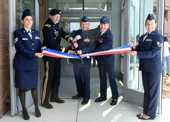 From left to right, Brig. Gen. Jeffrey Johnson, Col. Michael Richards and Brig. Gen. John DeGoes cuts the ribbon to officially open the undersea and hyperbaric medicine clinic, June 16, at the San Antonio Military Medical Center on Joint Base San Antonio-Fort Sam Houston, Texas. The hyperbaric medicine provides treatment for wound care, decompression sickness, arterial gas embolisms, carbon monoxide poisoning and provides the only active duty hyperbaric fellowship program