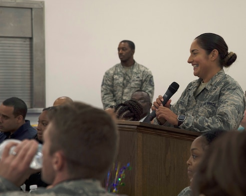 U.S. Air Force 2nd Lt. Magdalena Torres, the base support flight officer in charge assigned to the 6th Contracting Squadron, asks a question for the panel during a Pride Luncheon at MacDill Air Force Base, Fla., June 15, 2017. Torres is a member of the Pride Committee and said the goal for this year is to focus on educating members of MacDill about the significance of the month. (U.S. Air Force Photo by Airman 1st Class Ashley Perdue)
