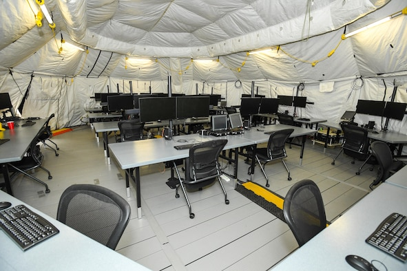 Pictured is the operator stations of the newly-fielded AN/TYQ-23A Tactical Air Operations Module. The new system services 18 operators, is highly transportable and requires less than half the set up time required for the old system. (U.S. Air Force photo/ R. Nial Bradshaw)