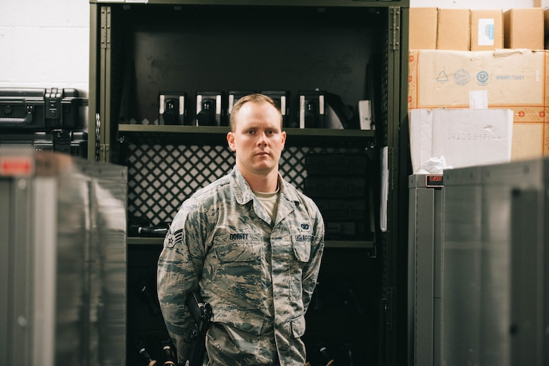 Senior Airman Chance Dority, 11th Security Support Squadron armorer, poses for a photo inside the armory at Joint Base Andrews, Md., June 12, 2017. Every day, the armory serves National Capital Region customers, including members of the 11th Security Forces Group, augmentees and private gun owners. (U.S. Air Force photo by Senior Airman Delano Scott)