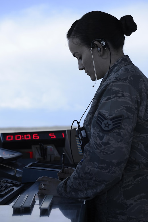 U.S. Air Force Staff Sgt. Amanda Ahsoak, air traffic control journeyman, checks flight plans for aircraft arriving at Joint Base Elmendorf-Richardson, Alaska, June 15, 2017. ATC Airmen are responsible for the safety and control of hundreds of military and civilian aircraft every day.
