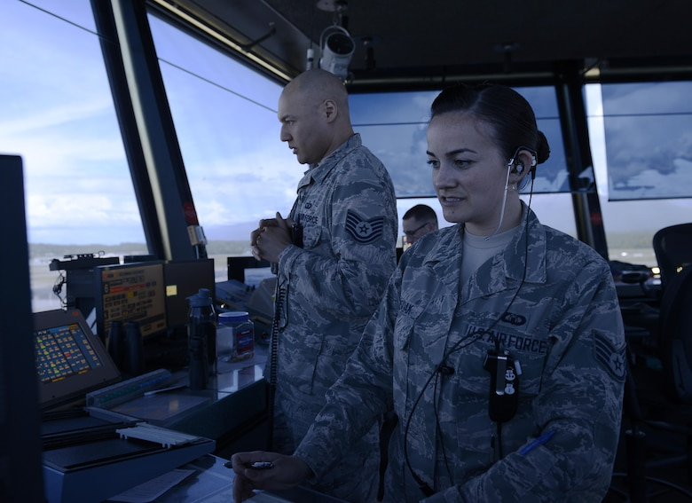 U.S. Air Force Staff Sgt. Amanda Ahsoak, air traffic control journeyman, and Tech. Sgt. Jason McLean, air traffic control tower watch supervisor, give direction to an inbound aircraft, Joint Base Elmendorf-Richardson, Alaska, June 15, 2017. ATC Airmen are responsible for the safety and control of hundreds of military and civilian aircraft every day.