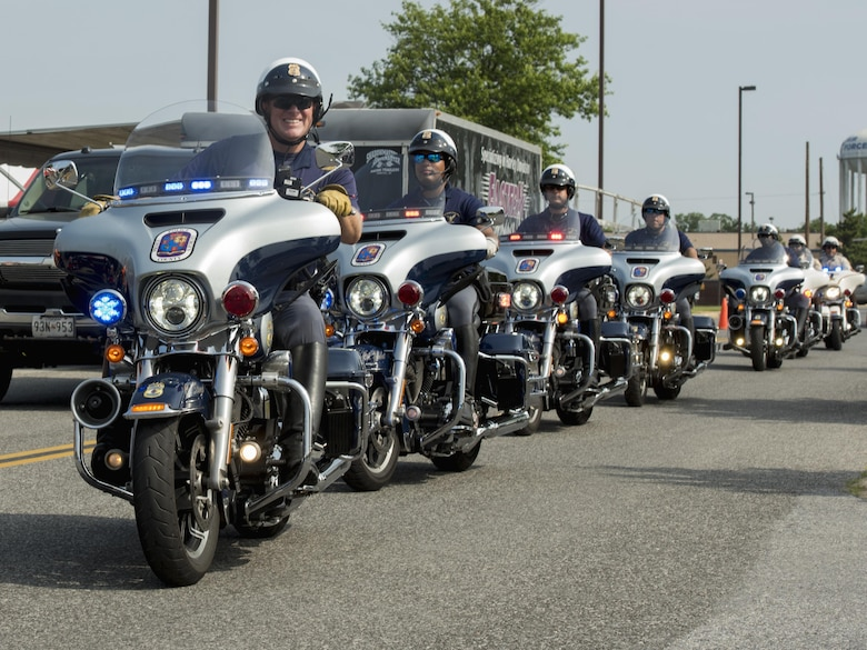 Prince George's County policemen ride in formation during the Seventh Annual Motorcycle Safety Day at Joint Base Andrews, Md., June 15, 2017. This year's MSD was considerably larger compared to previous years and was supported by more than five law enforcement departments, including the Anne Arundel County Police, Virginia State Police and Prince George's County Sheriff's Department. (U.S. Air Force photo by Airman 1st Class Valentina Lopez)