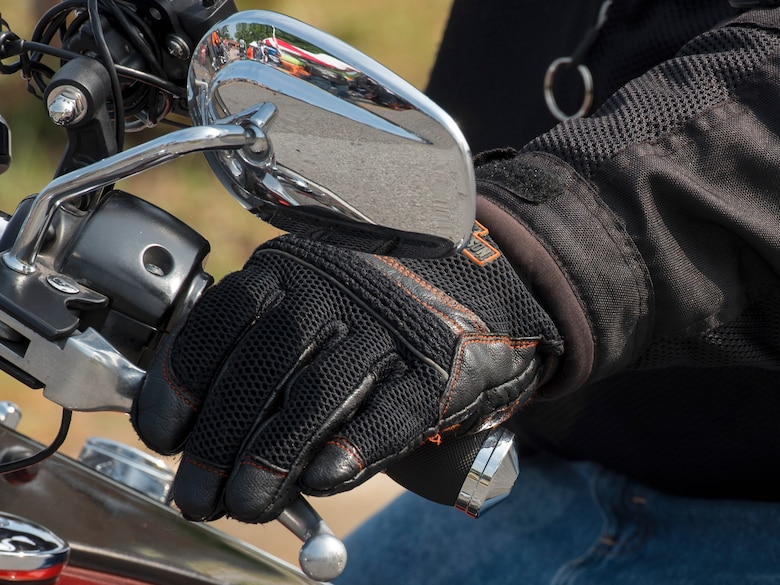 A motorcyclist grips their motorbike handle during the Seventh Annual Motorcycle Safety Day at Joint Base Andrews, Md., June 15, 2017. The event provided demonstrations and safety tips to help reduce accidents among riders. (U.S. Air Force photo by Airman 1st Class Valentina Lopez)