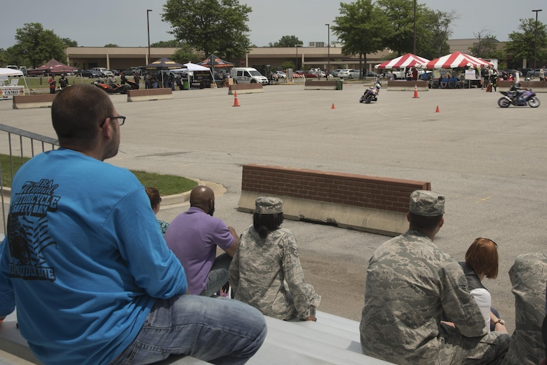 Motorcycle safety day attendees watch a motorcycle demonstration during the Seventh Annual Motorcycle Safety Day at Joint Base Andrews, Md., June 15, 2017. The demonstration, performed by professional motorcycle racers, displayed safety maneuvers to conduct during a race. (U.S. Air Force photo by Airman 1st Class Valentina Lopez)
