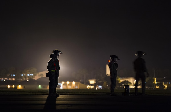 Air Commandos with the 1st Special Operations Logistics Readiness Squadron wait for a Pilatus PC-12 assigned to the 319th Special Operations Squadron to taxi to a forward area refueling point at Hurlburt Field, Fla., June 13, 2017. The FARP program is a United States Special Operations Command initiative that performs nighttime refueling operations in deployed locations where fueling stations are not accessible or when air-to-air refueling is not possible. (U.S. Air Force photo by Airman 1st Class Joseph Pick)