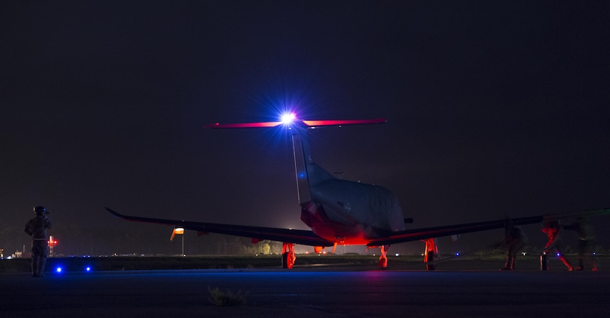 Air Commandos with the 1st Special Operations Logistics Readiness Squadron prepare to refuel a Pilatus PC-12 assigned to the 319th Special Operations Squadron during a forward area refueling point operation at Hurlburt Field, Fla., June 13, 2017. Forward area refueling points enable global reach and mission accomplishment. (U.S. Air Force photo by Airman 1st Class Joseph Pick)