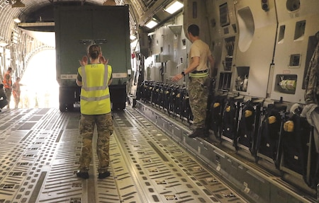 The Joint Air Delivery Test and Evaluation Unit of the Royal Air Force loads equipment onto a British registered C-17 with Soldiers from 1st Infantry Division Sustainment Brigade May 26 at Salina Regional Airport, Salina, Kansas. Working within a North Atlantic Treaty Operation, the JADTEU from the United Kingdom provides air portability assurance to deliver American equipment to support the United States Army. This operation is part of ongoing interoperability between the two nations.